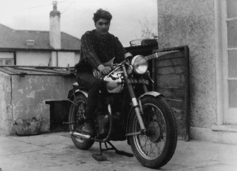 Roy astride the 500cc BSA motorbike that he restored from scratch in 1963, with his homemade guitar slung across the tank.