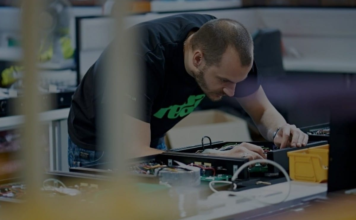 A Rega employee hard at work in the factory.